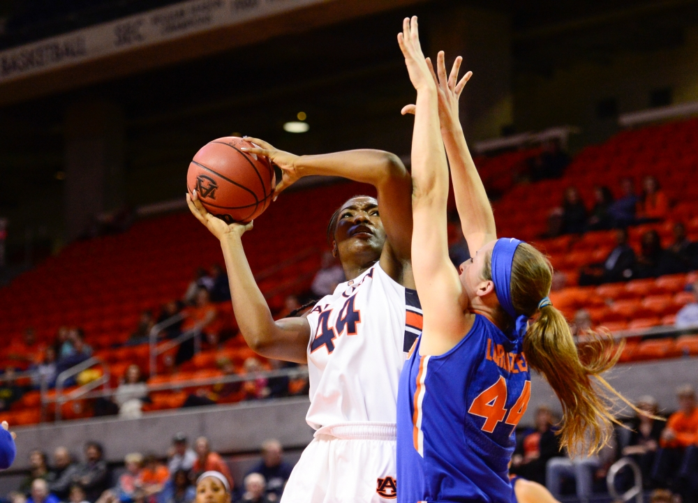 Tra'cee Tanner fights for 2 of her 12 points in  Auburn's 63-50 loss to Florida at Auburn Arena, Sunday, January 4, 2014.  Photo by Wade Rackley/Auburn Athletics