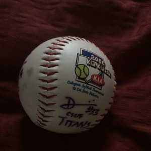 An autographed softball featuring players from CSUF, Arizona and Tennessee in the 2000 KIA Classic in Fullerton, CA.