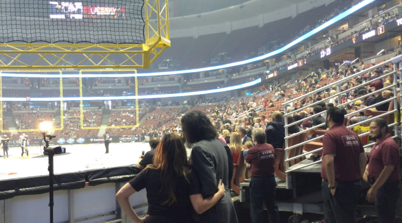 Girly Locker Room's Jackie James with LA Kiss co-owner Gene Simmons, August 8, 2015 at Honda Center in Anaheim, California.
